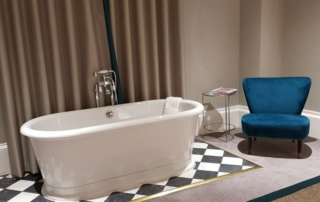 Bath, chair and table furniture in hotel room