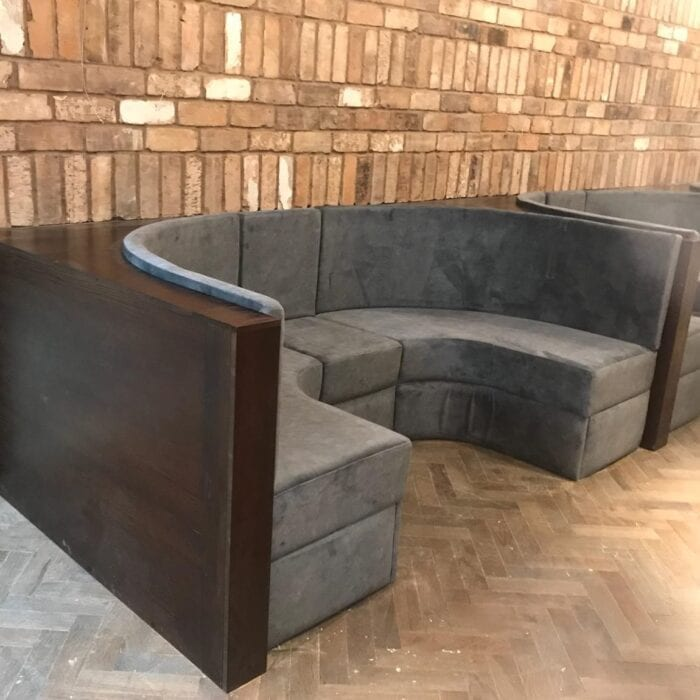 semi-circle contract furniture banquette seating with stone wall