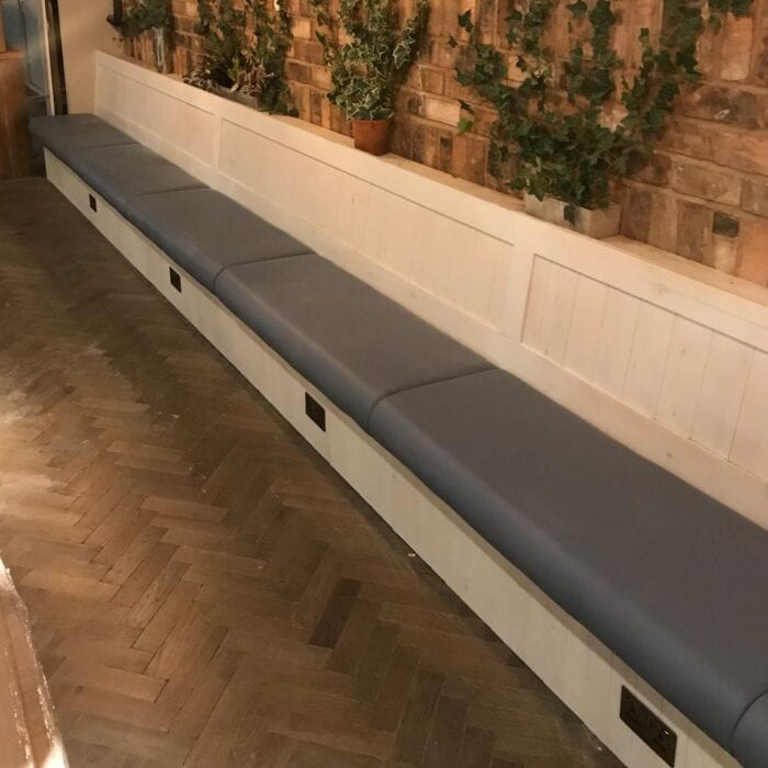 long contract banquette seating in restaurant