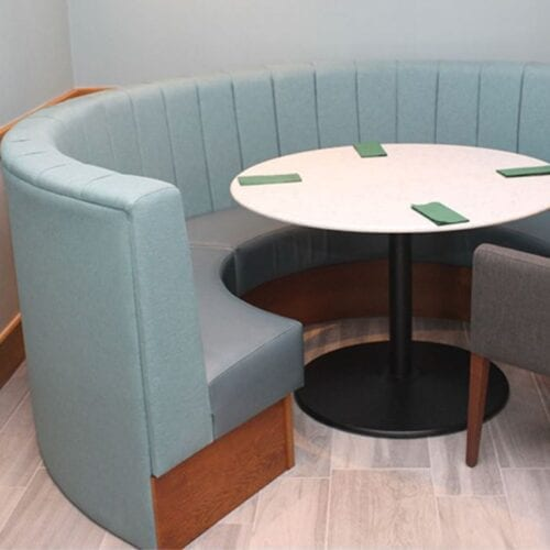 Circular Banquette seating with table and napkins