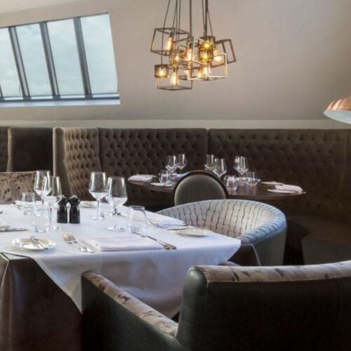 table, chairs and lighting for hotel dining
