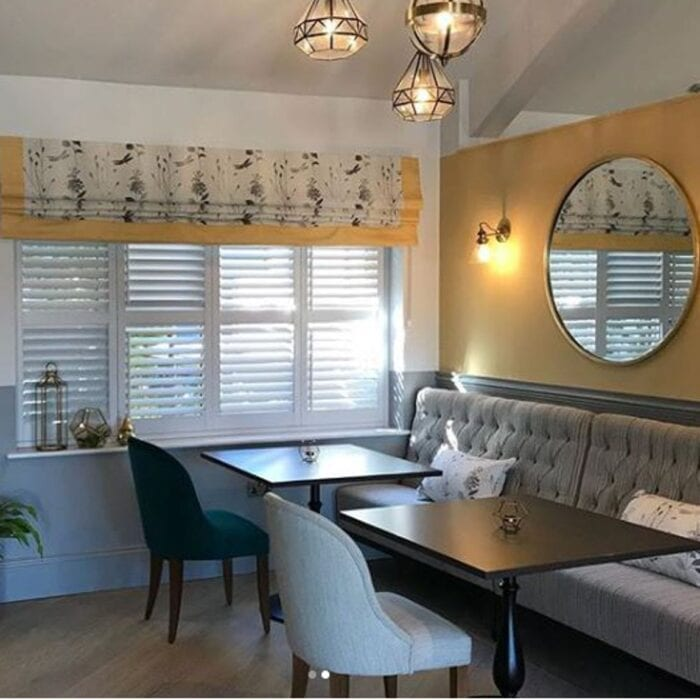 sleek seating area in tea room with banquette