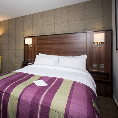 hotel bedroom large headboard and bed