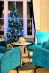 Contract chairs and table next to Christmas tree in hotel