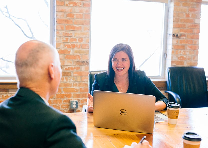 friendly sales manager with laptop and coffee