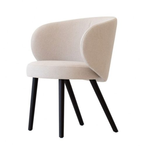 slightly angled front view of upholstered Evie armchair