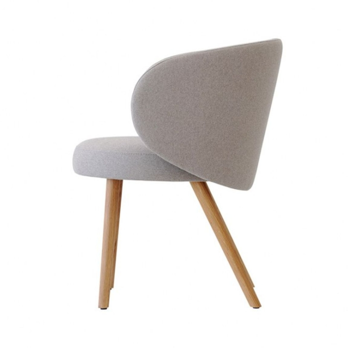 side view of Evie armchair showing round shape of armrests
