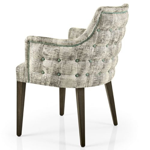 side view of hanna dining armchair with buttoned outer back