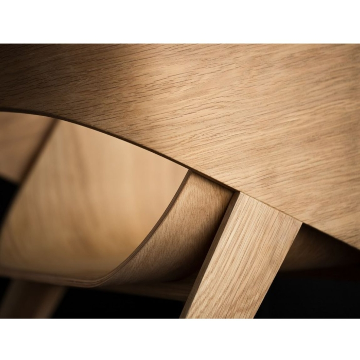 close up view of the wood finish on the Slim armchair
