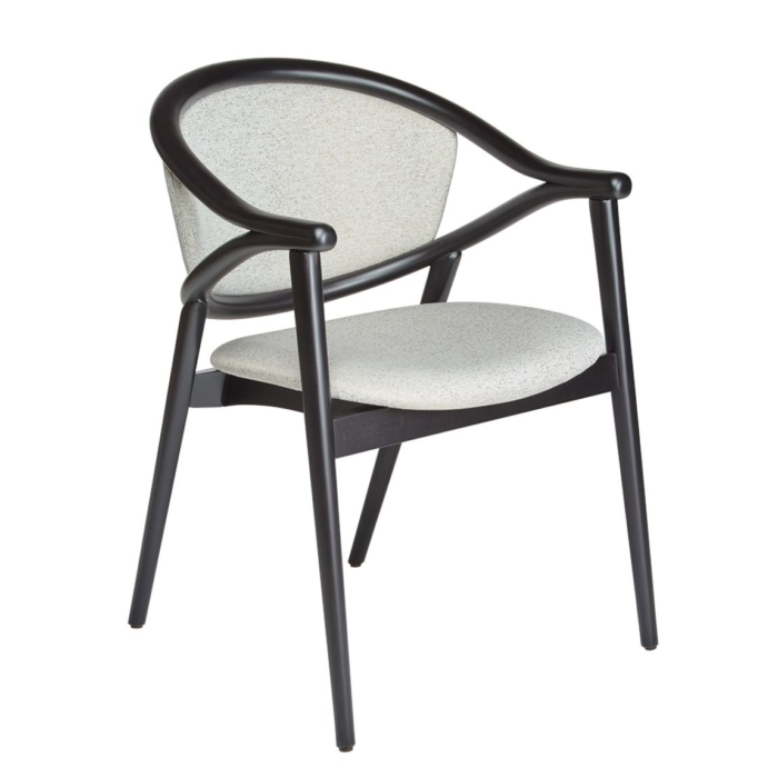 angled view of umami armchair with upholstered seat and back rest