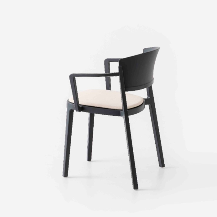 angled side view of the abuela armchair with upholstered seat pad
