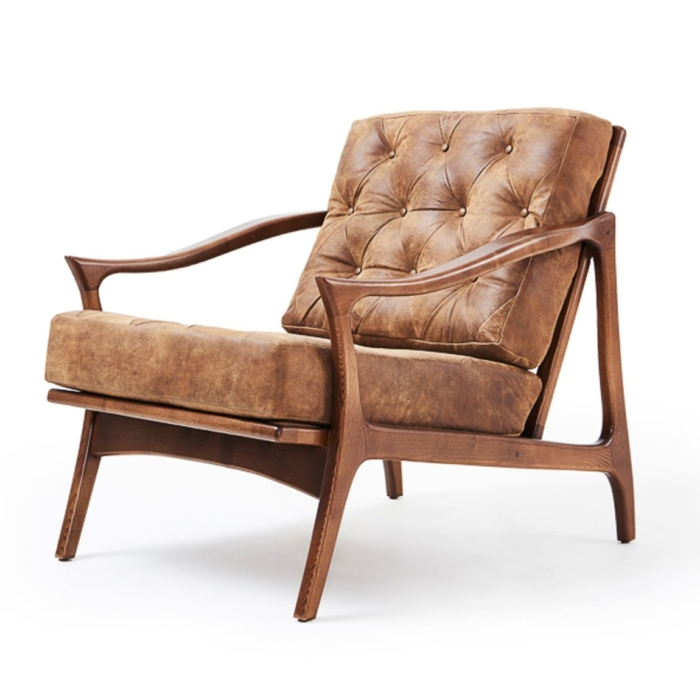 Slightly angled view of Lordelo lounge armchair with wooden armrests and buttoned inner back rest
