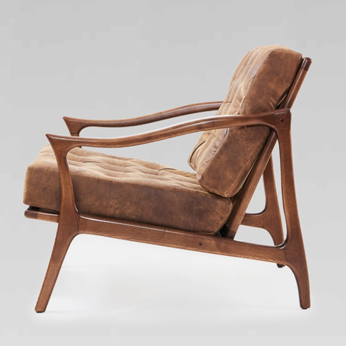 Side view of wooden armchair showing shape of the wood
